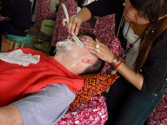 Michael getting a straight razor shave in Siem Reap, Cambodia