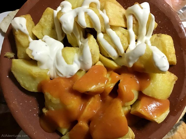 what to eat in Madrid - Madrid food tour potatoes patatas bravas