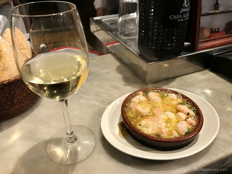 what to eat in Madrid - Madrid food tour garlic shrimp and wine