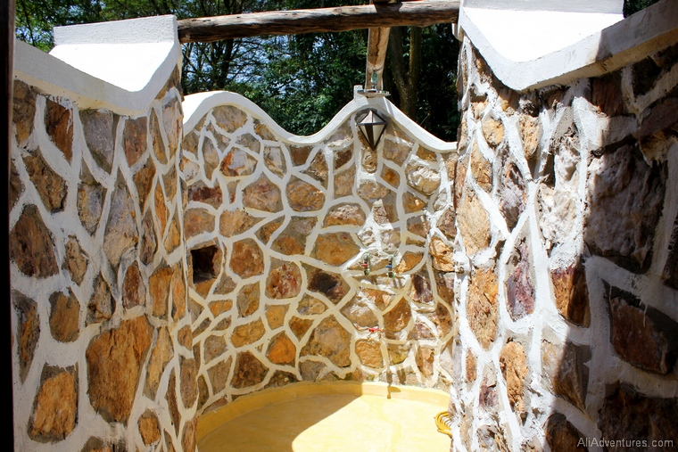 safari in Uganda where to stay in Queen Elizabeth National Park south outdoor shower